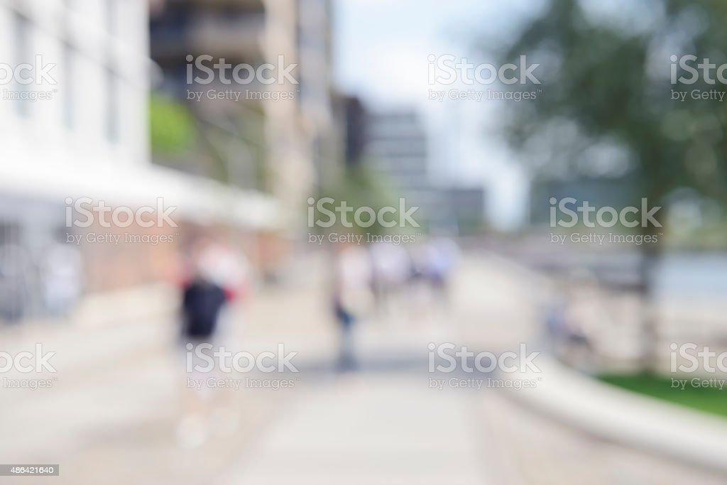 Intentionally defocused promenade with pedestrians at Hamburg Hafencity stock photo