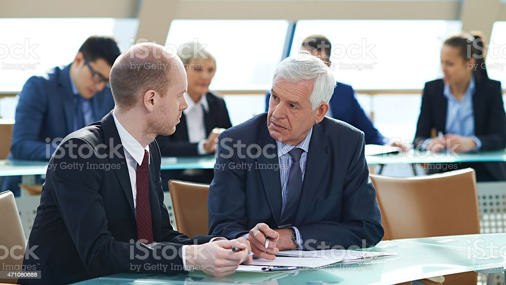 Interacting at conference stock photo