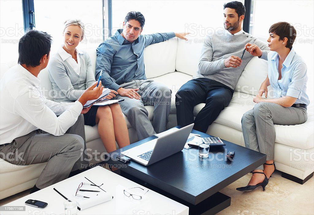 Interacting business people stock photo