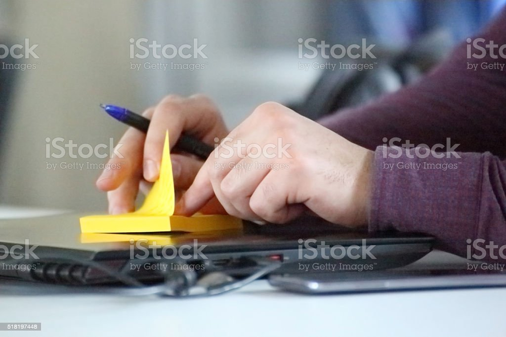 Interacting with adhasive paper stock photo