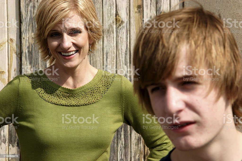 interaction portrait - middle aged woman teen son royalty-free stock photo