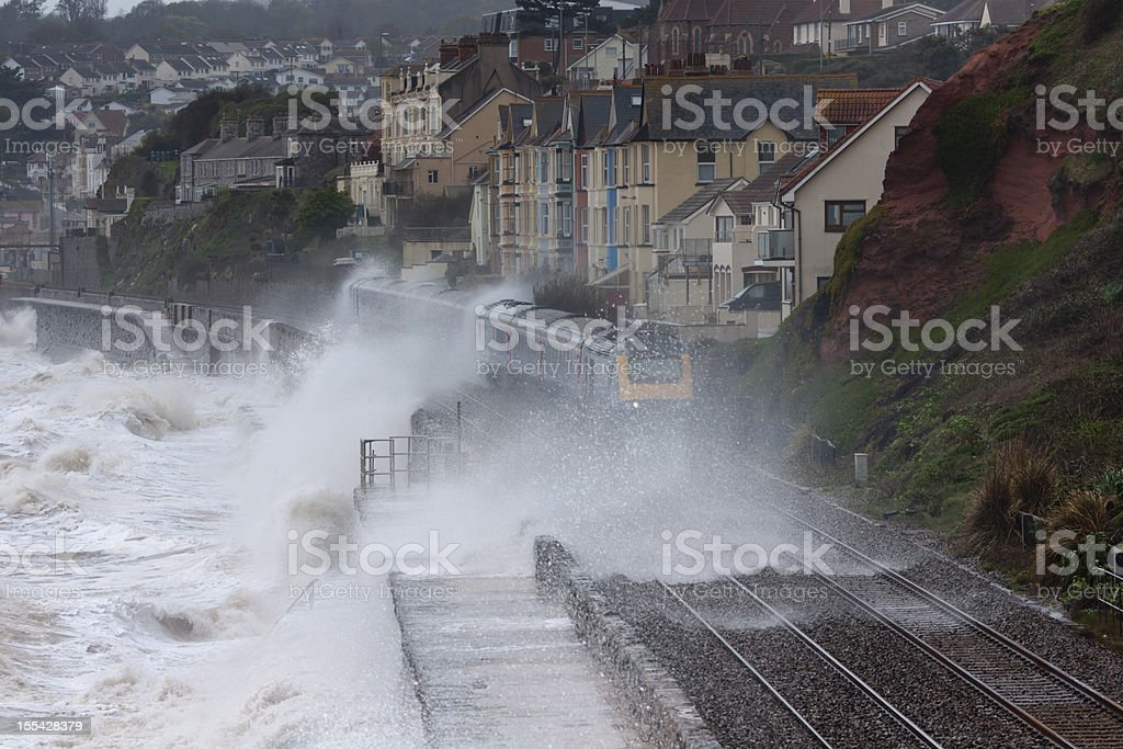 Intercity express with waves breaking over at Dawlish Devon stock photo