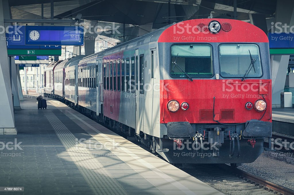 Intercity train at a station platform stock photo