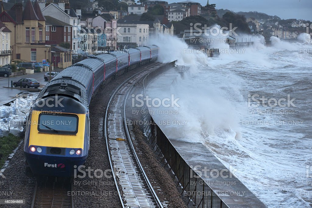 Intercity train getting a soaking at Dawlish during severe storm stock photo