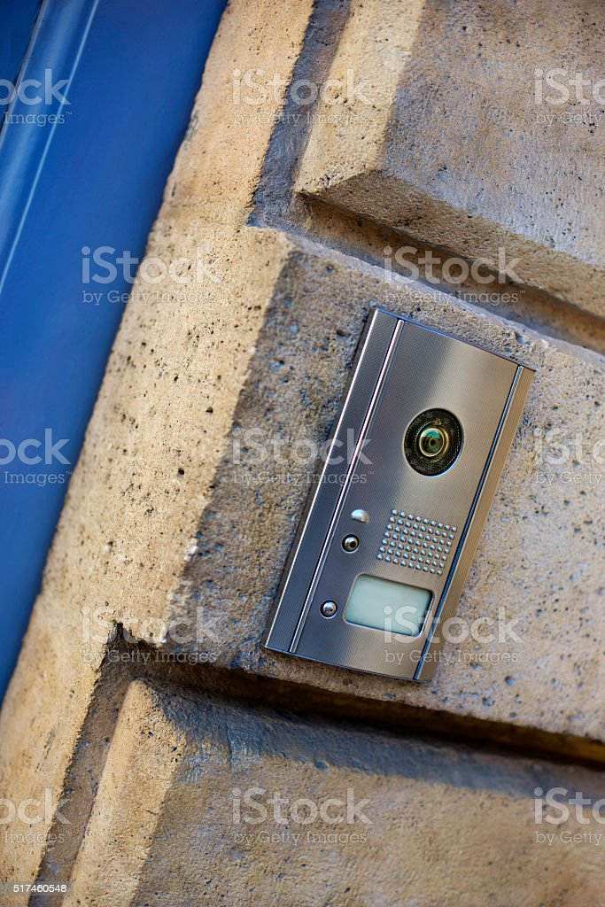 Intercom on a stone wall stock photo