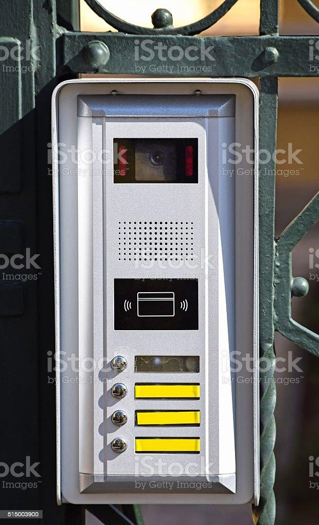 Intercom on the metal door fence stock photo