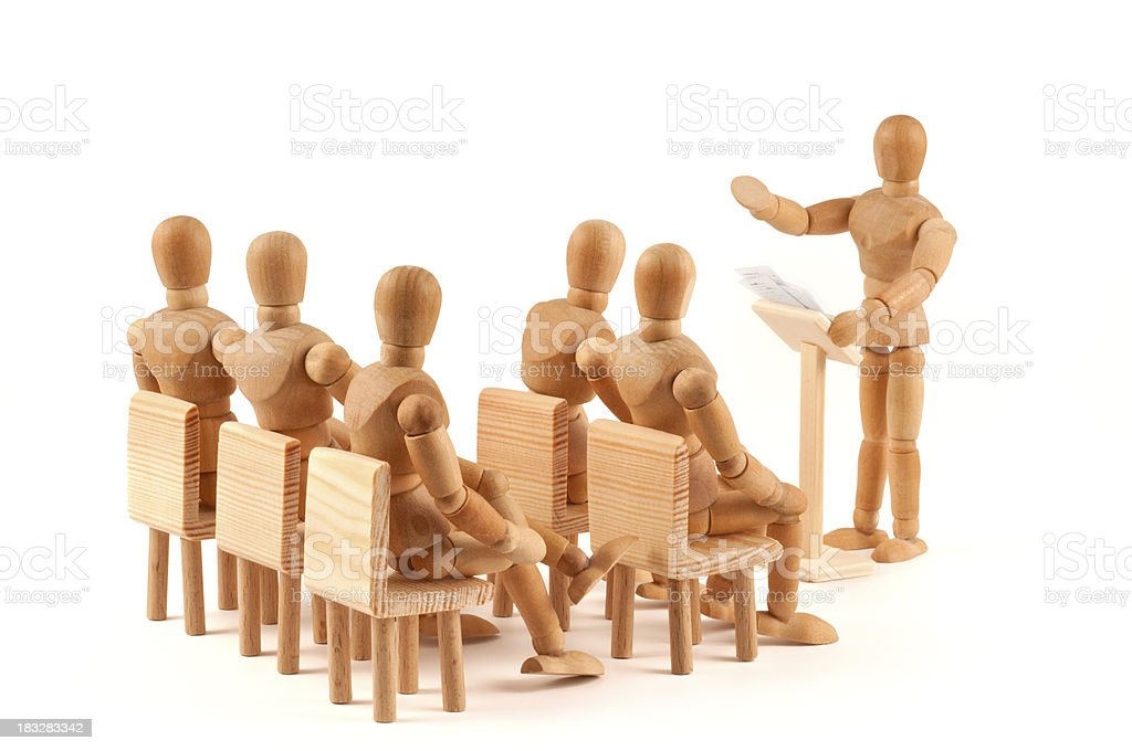 interested auditors -  meeting of wooden mannequins stock photo