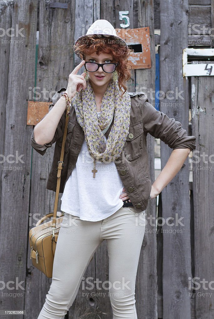 Interested hipsted girl with bag royalty-free stock photo