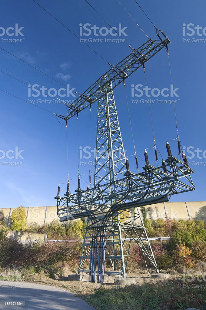 Interface between a high-voltage line and an underground cable stock photo