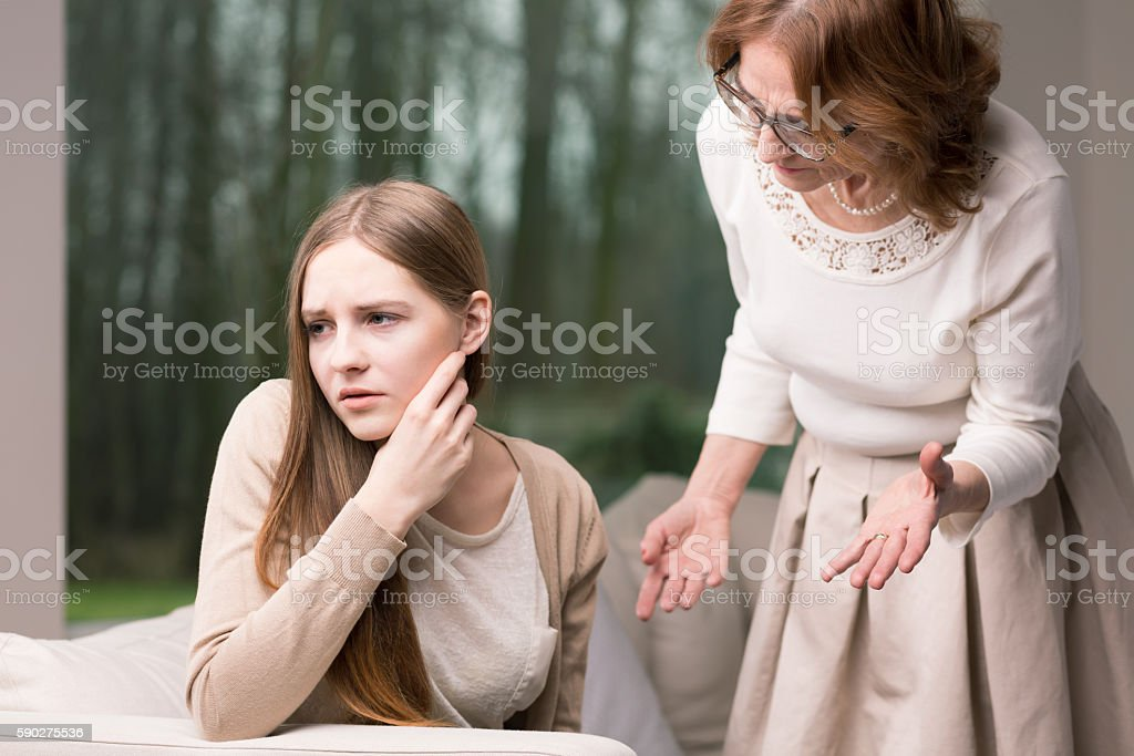 Intergenerational argument between mother and daughter stock photo