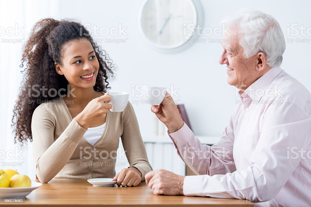 Intergenerational discussion with cup of coffee stock photo