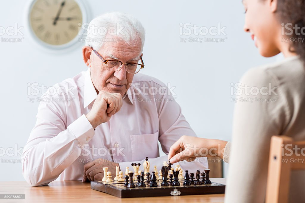 Intergenerational duel at chess stock photo
