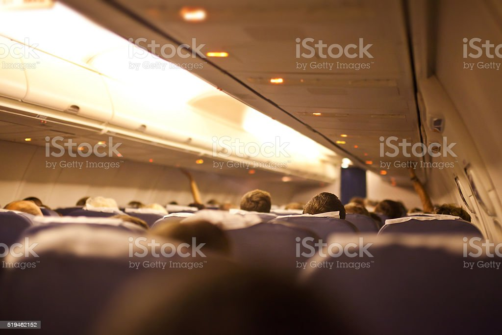 Interior airplane with passengers, focus on passenger head stock photo