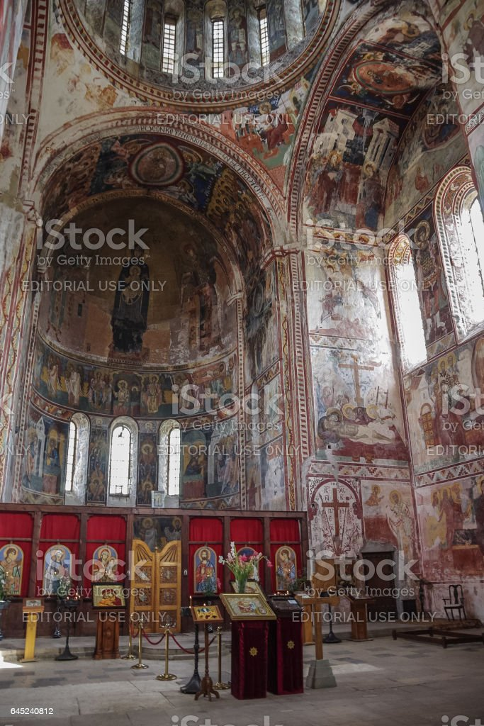 Interior and frescoes of church in Gelati stock photo