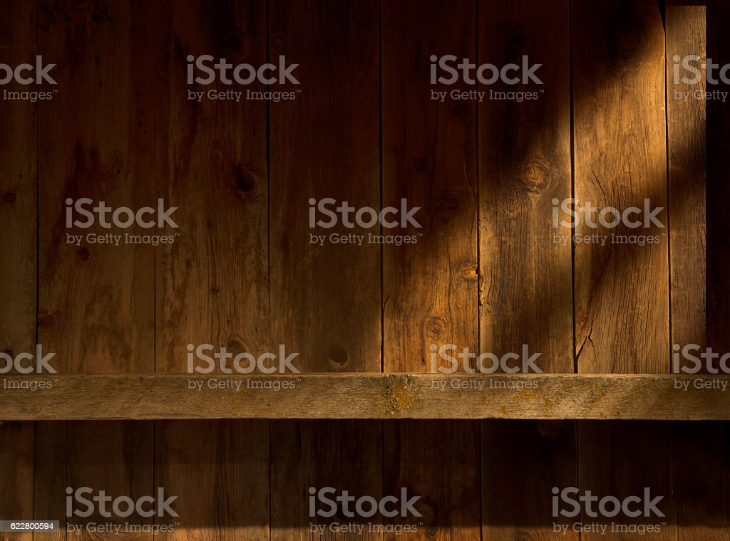 Interior barn wood wall and mantel with sunstreaks stock photo