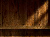 Interior barn wood wall and mantel with sunstreaks