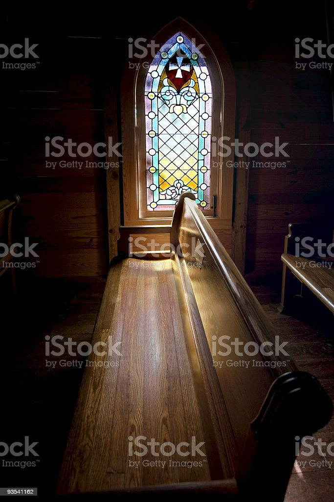 Interior church w: stain glass window stock photo