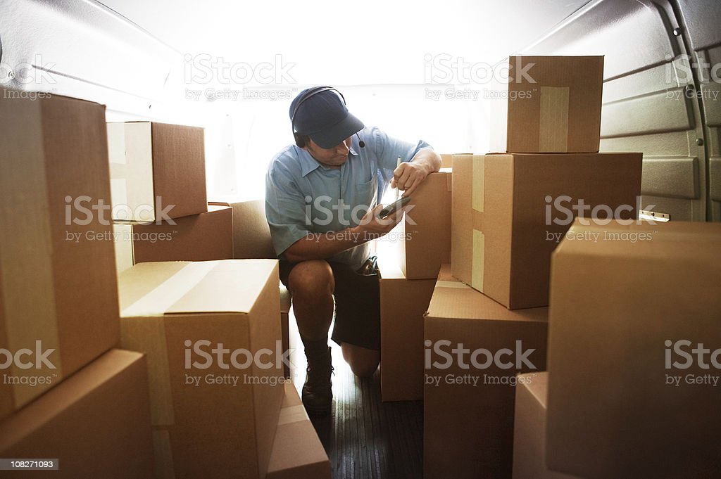 Interior Courier Van Loaded with Boxes stock photo