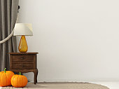Interior decoration for Halloween with wooden bedside table