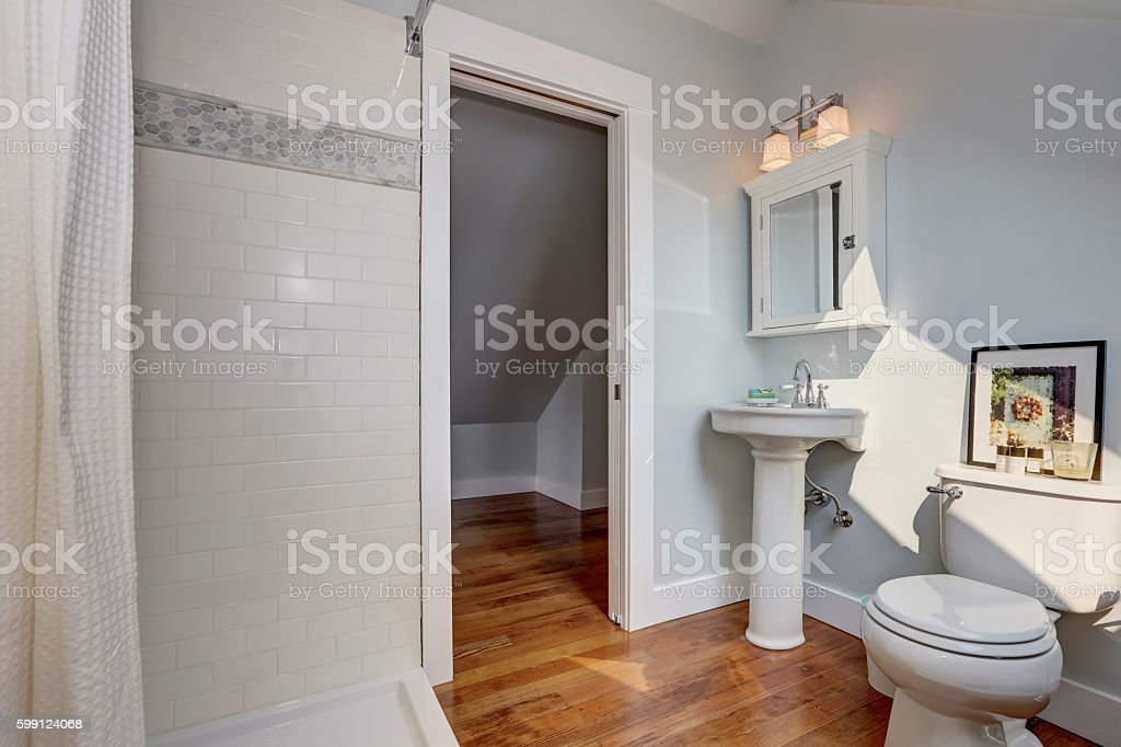 Interior design of craftsman bathroom with pastel blue walls stock photo
