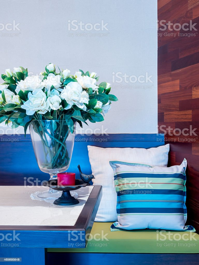 Interior design of modern dining table  with artificial flower stock photo