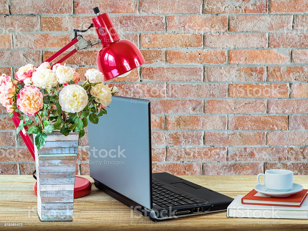 Interior Design Of Working Table With Laptop Computer Flower Vase Royalty Free Stock Photo