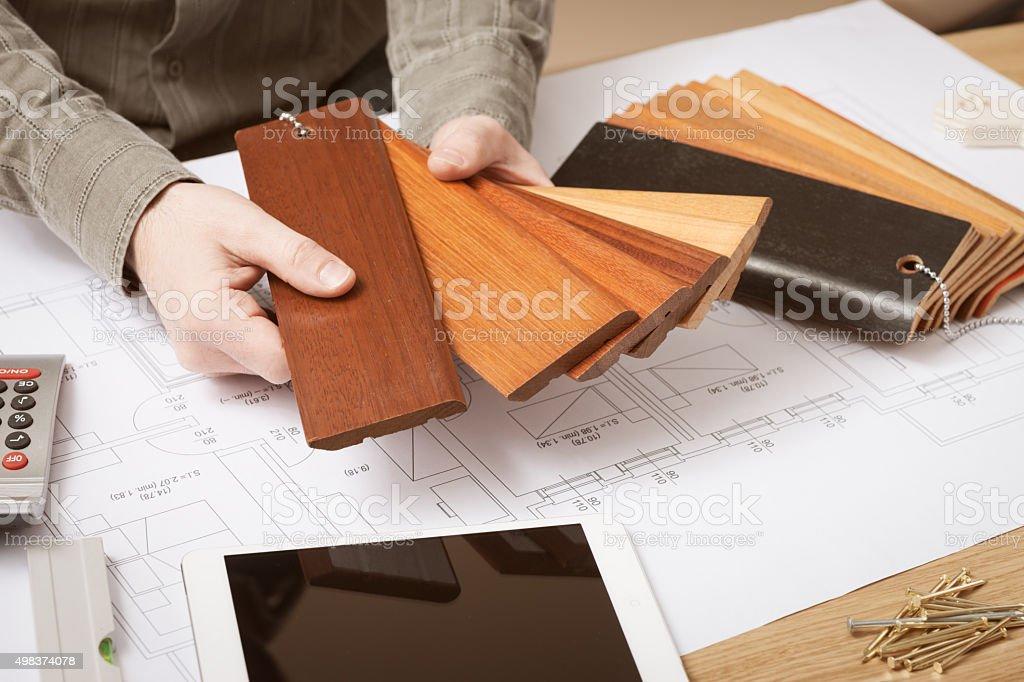 Interior designer choosing a baseboard stock photo