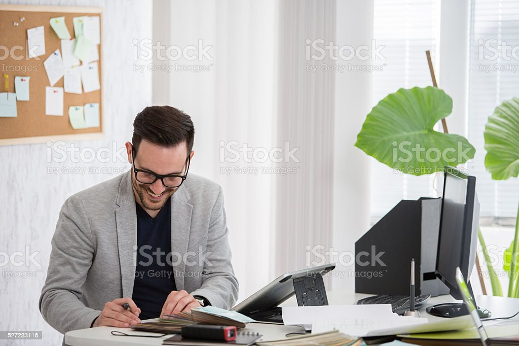 Interior designer choosing samples stock photo