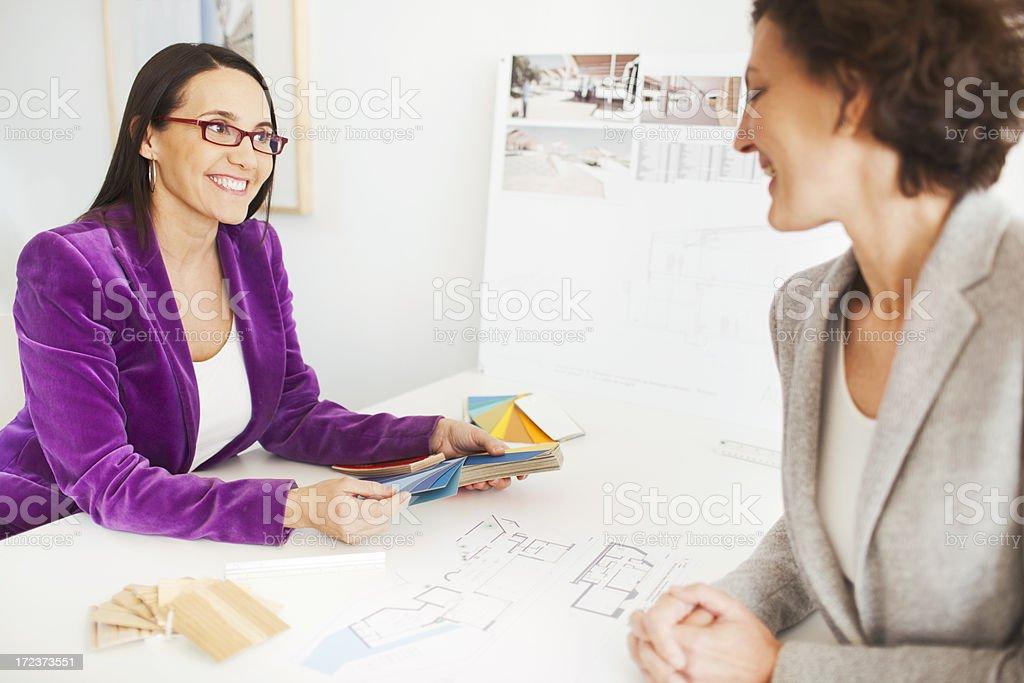 Interior designer discussing colors with client. stock photo
