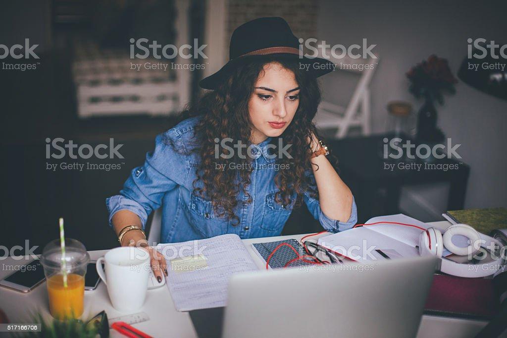 Interior designer using laptop in modern office stock photo
