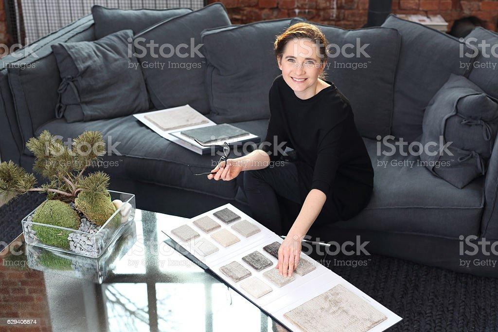 Interior designer with the probe carpets stock photo