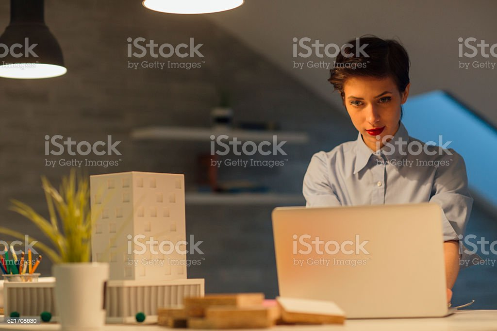 Interior Designer Working Late In Her Office. stock photo
