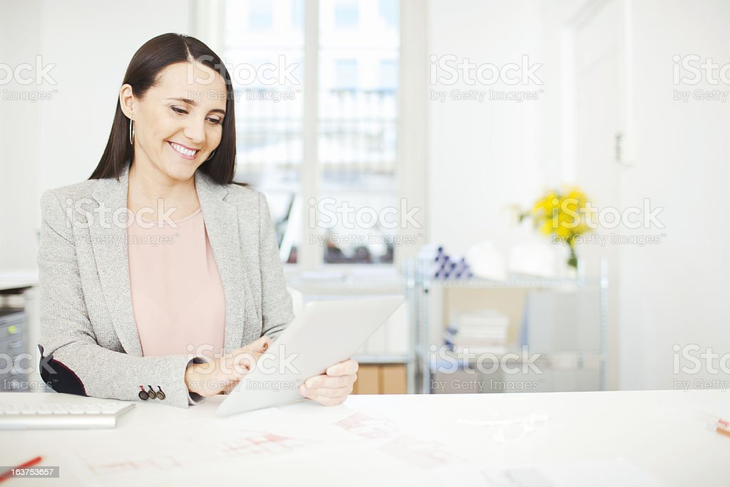 Interior designer working with digital tablet. stock photo