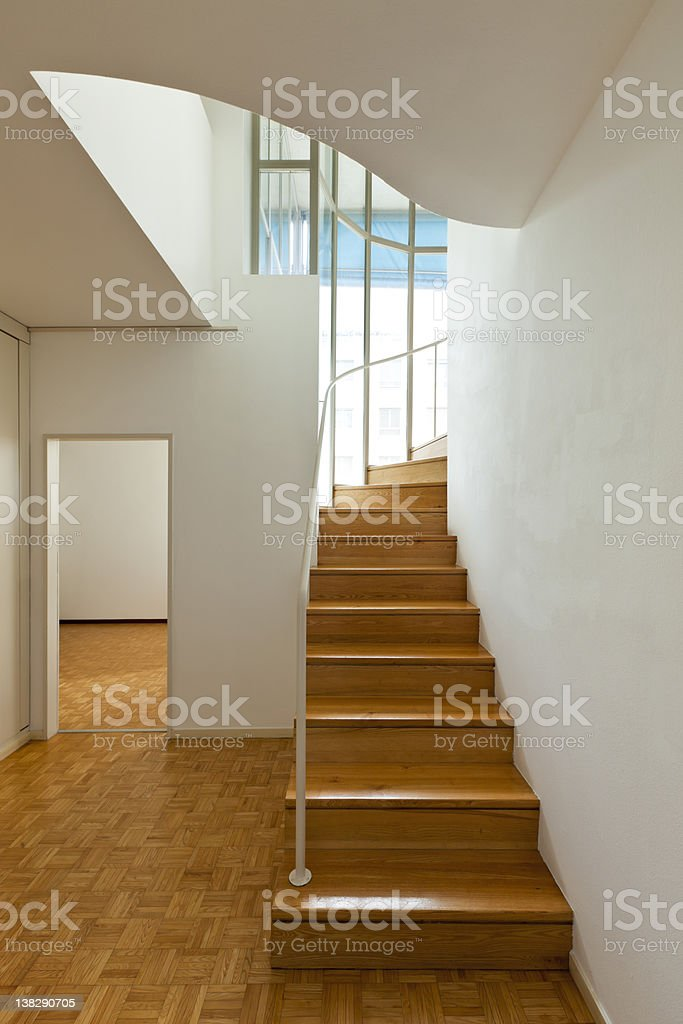 interior duplex, wooden stairs royalty-free stock photo