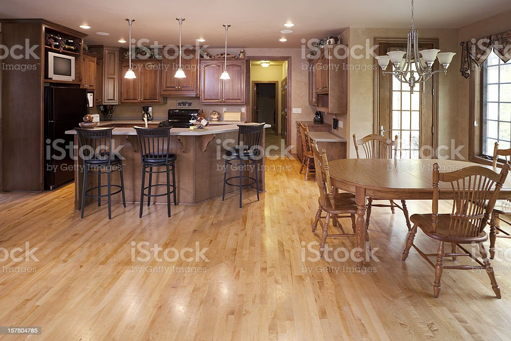 Interior Home Design; Eat-In Kitchen With Dinette and Hardwood Floor stock photo