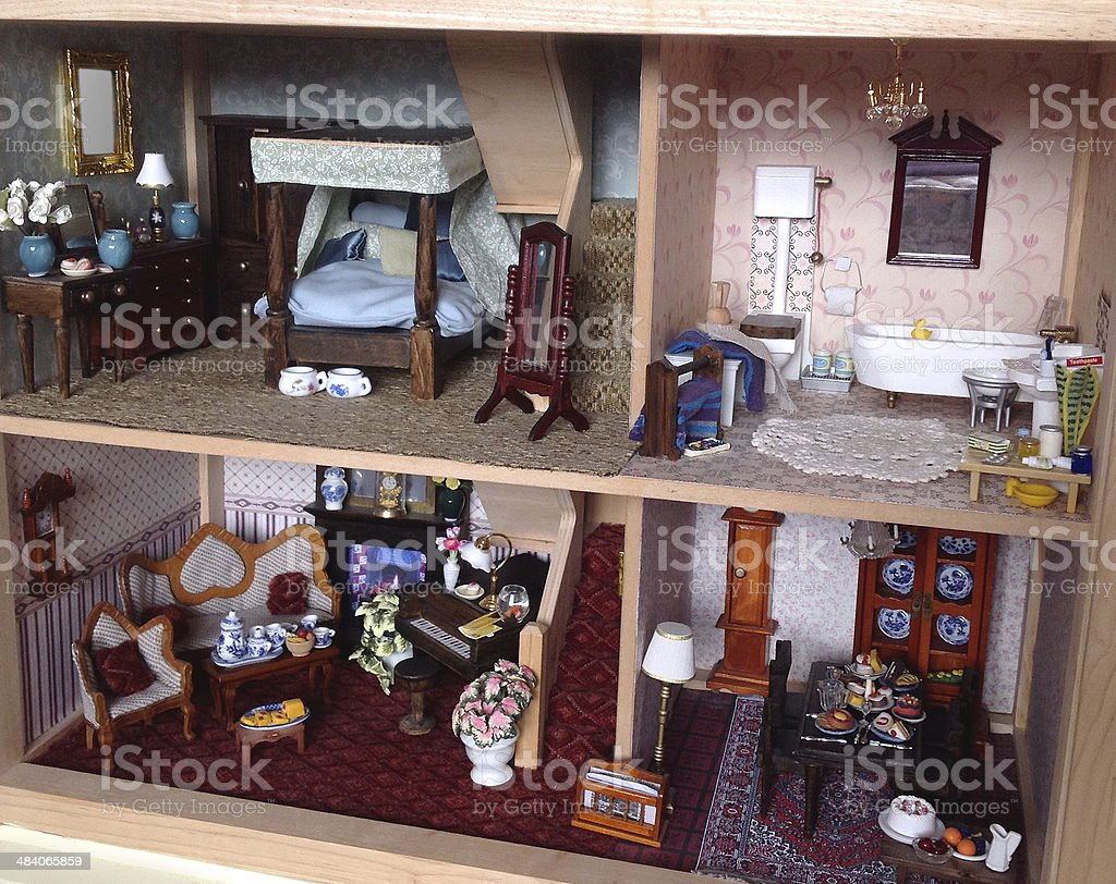 Interior image of dolls house, with bedroom, bathroom and lounge stock photo