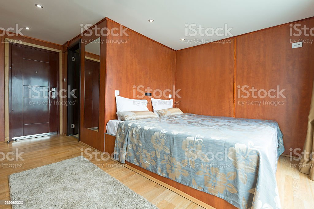 Interior of a cabin bedroom on cruise boat hotel stock photo