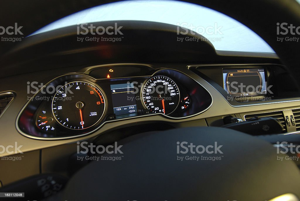 Interior of a car with the dashboard lit up stock photo