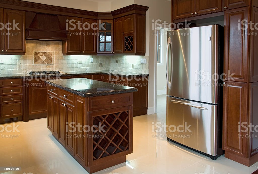 Interior of a dark oak wood kitchen with marble countertops stock photo