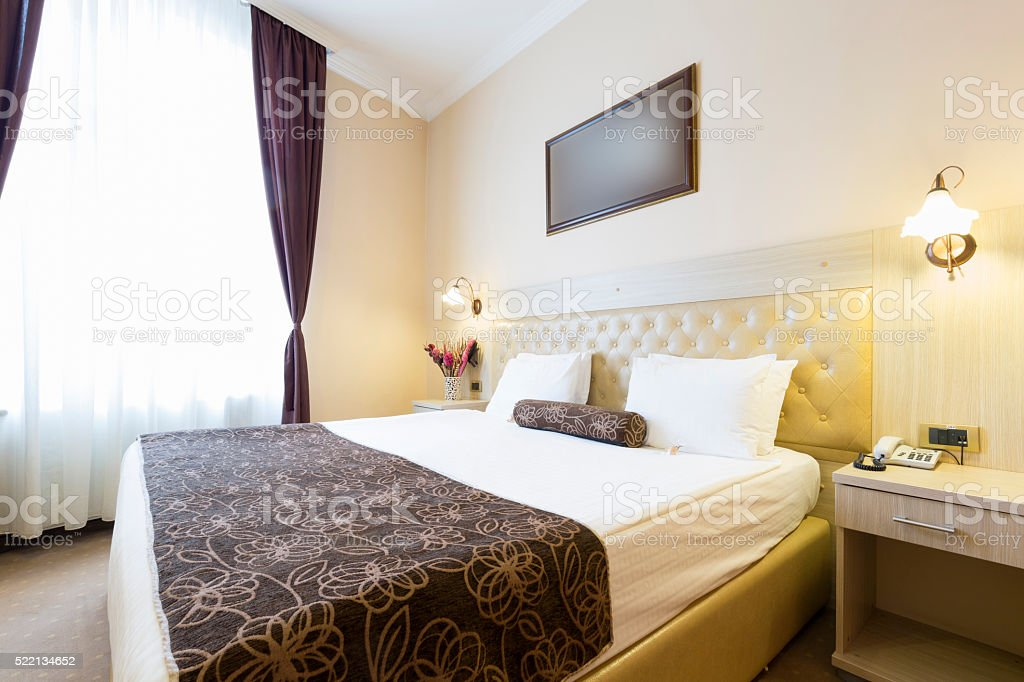 Interior of a hotel bedroom stock photo