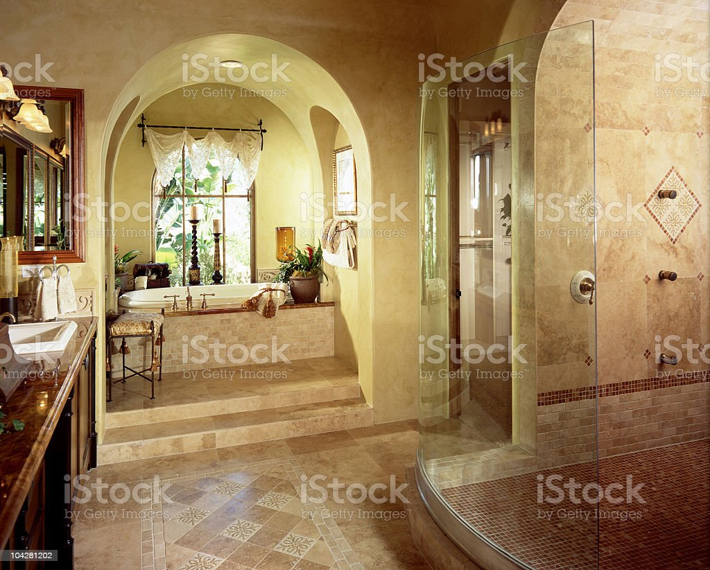 Interior of a luxury bathroom with stand up shower and tub  stock photo