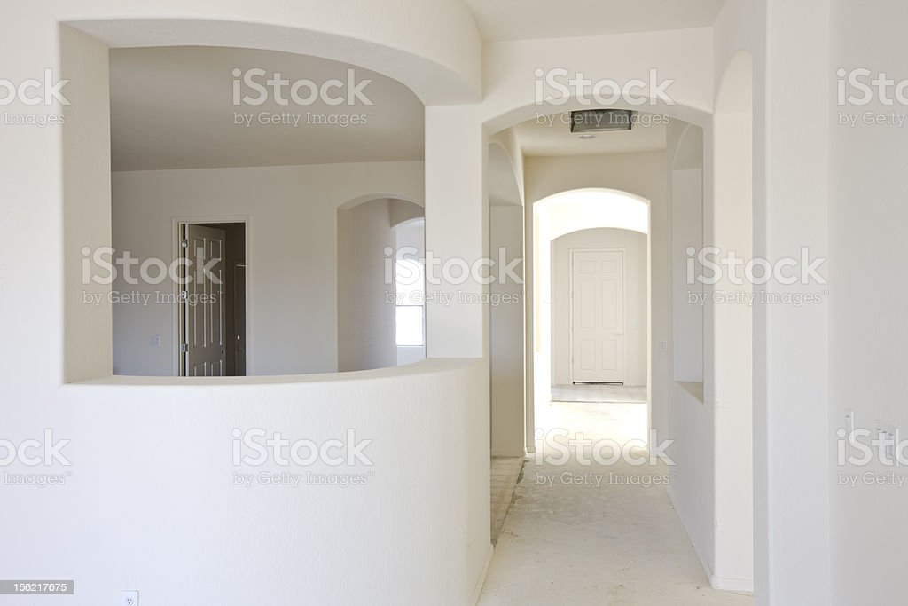 Interior of a new construction house with drywalled rooms royalty-free stock photo