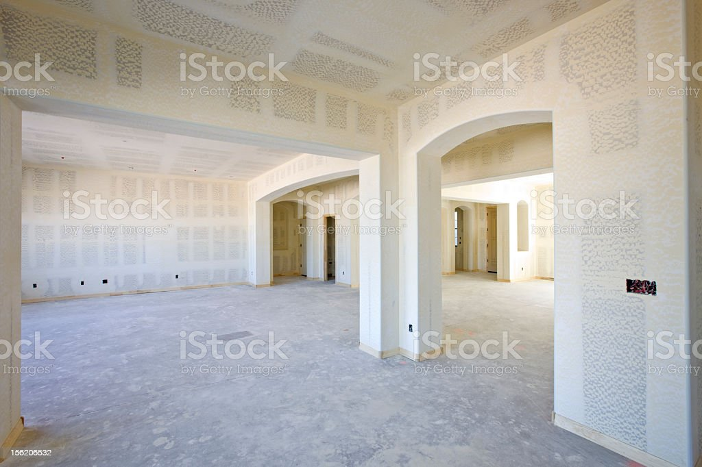 Interior of a newly-constructed home with blank drywall stock photo
