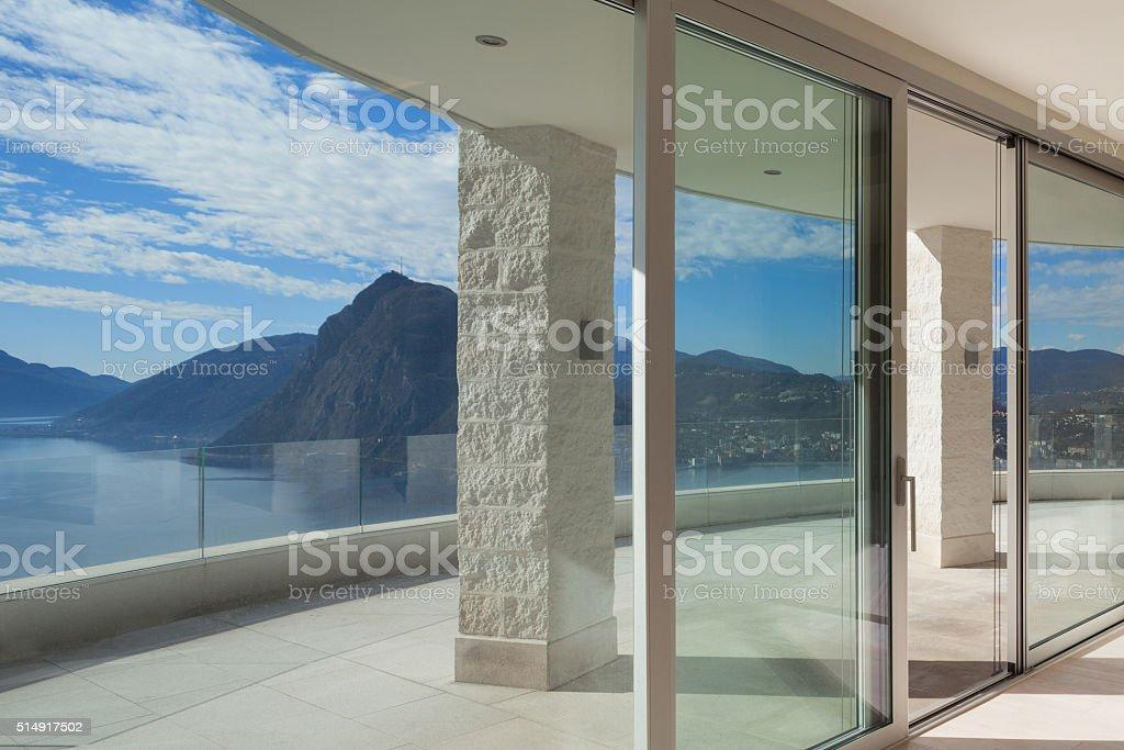 Interior of a penthouse, windows stock photo