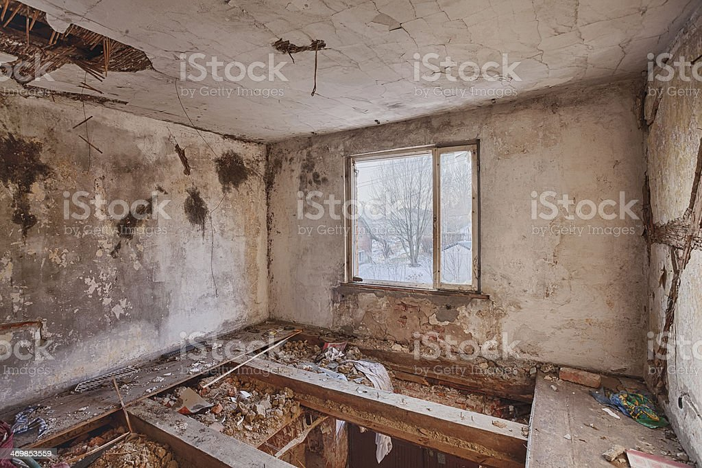 Interior of a ruined house stock photo