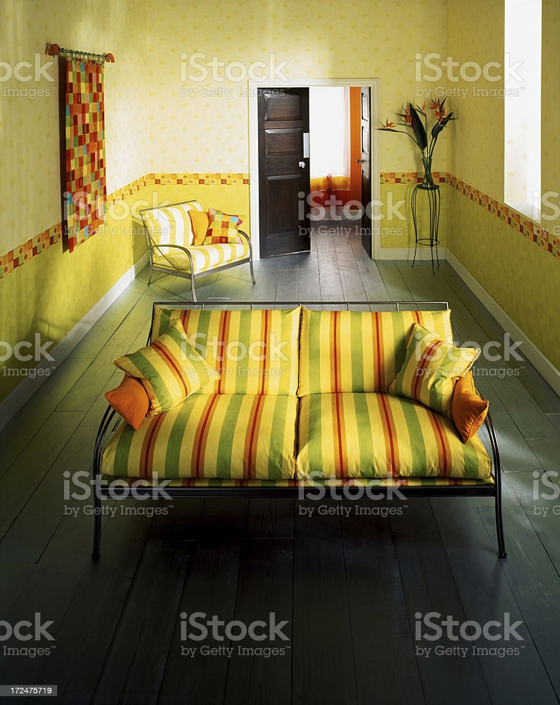 Interior of a small colourful living room royalty-free stock photo