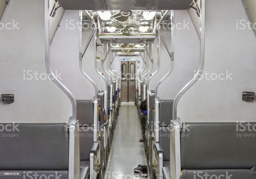 Interior of an empty antiqued train cabin in Thailand background. stock photo