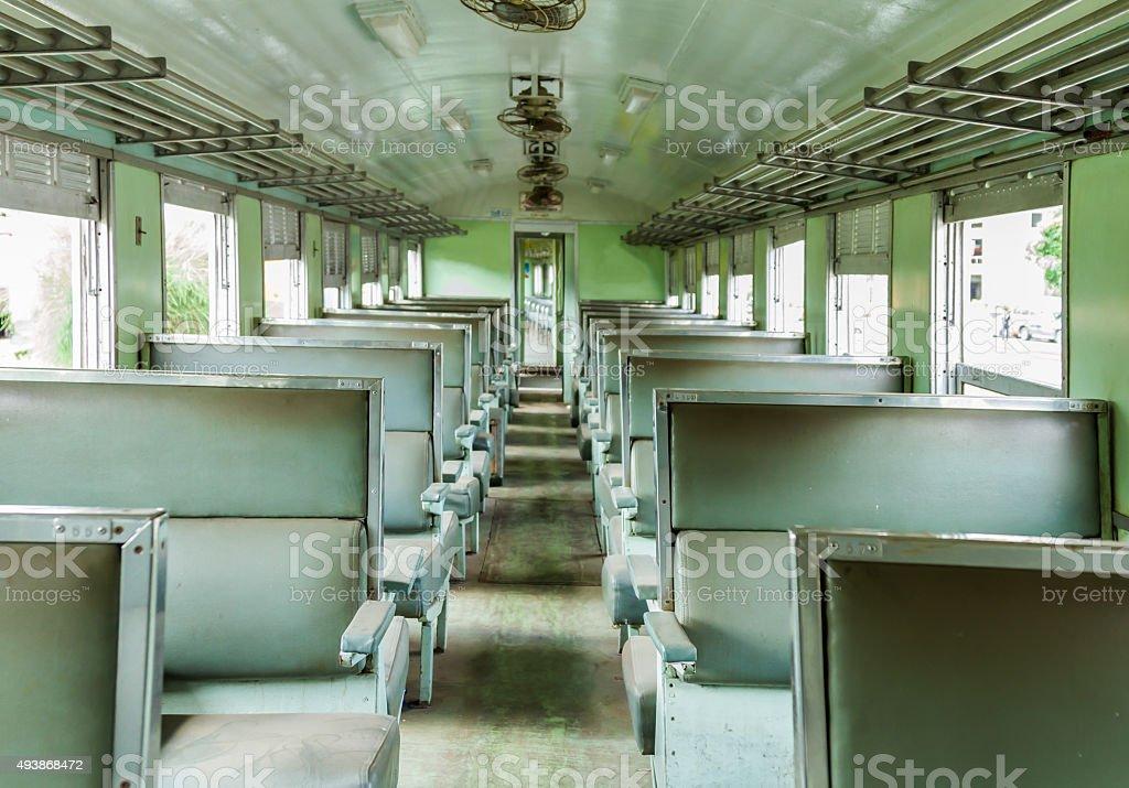 Interior of an empty antiqued train cabin in Thailand. stock photo
