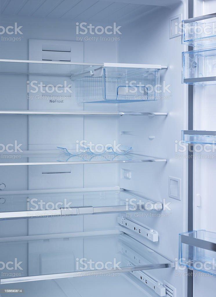 Interior of an empty open white refrigerator stock photo