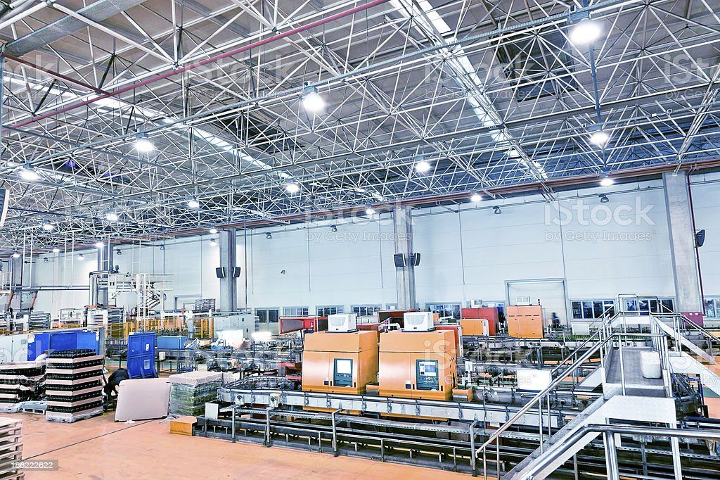 Interior of an industrial factory featuring machines stock photo